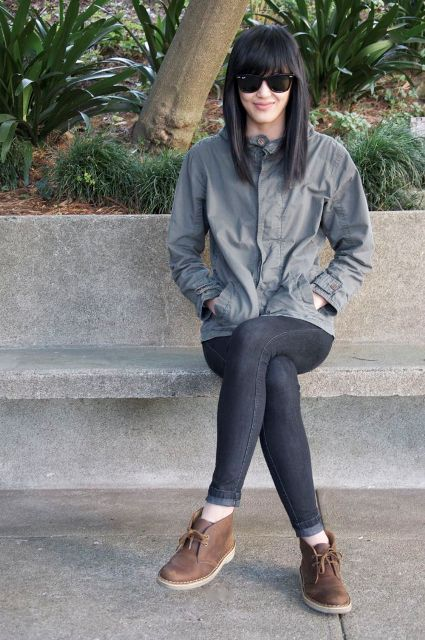 With sporty jacket and skinny jeans