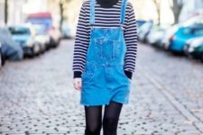With striped shirt, denim dress, black tights and black boots