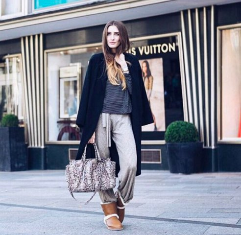 With striped shirt, gray sporty pants, printed bag and midi coat