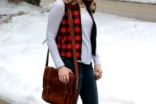 With striped shirt, jeans, brown high boots and brown leather bag