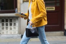 With striped shirt, yellow jacket, crop jeans, black leather boots and ring handle bag