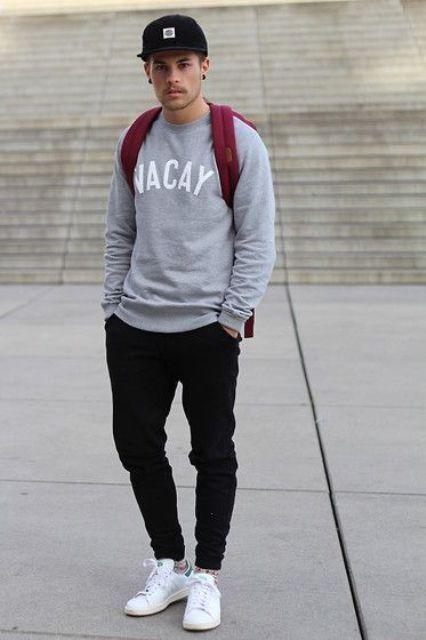 With sweatshirt, black pants, white sneakers and marsala backpack