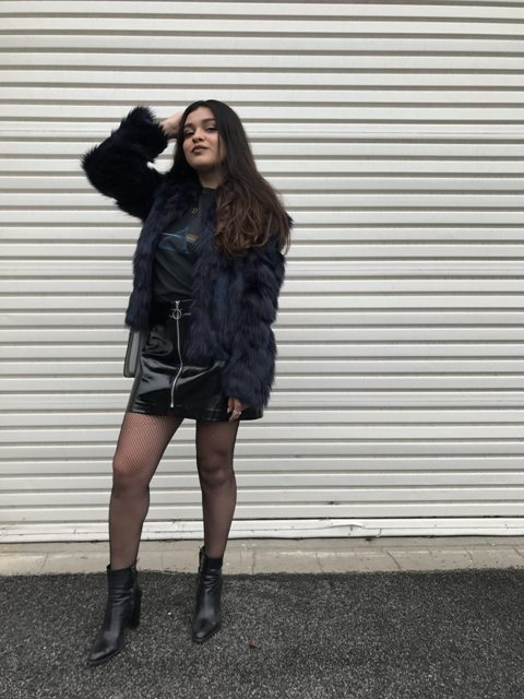 With t-shirt, ankle boots and fur jacket