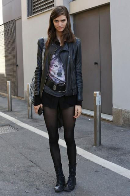 With t shirt, black belt, black jacket and printed bag