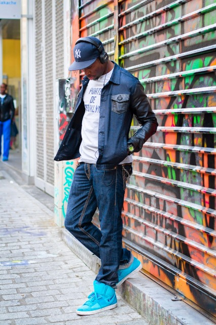 With t-shirt, denim jacket, jeans and bright colored shoes