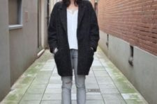 With white blouse, distressed jeans and black coat