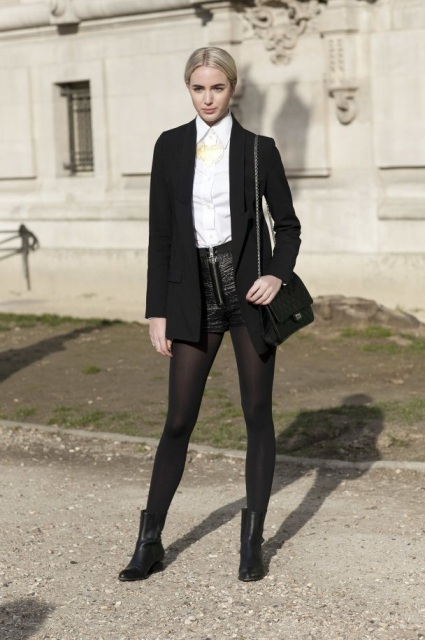 With white button down shirt, black blazer, small bag and ankle boots