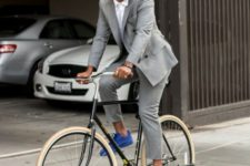 With white button down shirt, gray suit and blue sneakers
