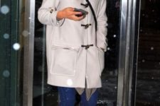 With white coat, jeans and high boots