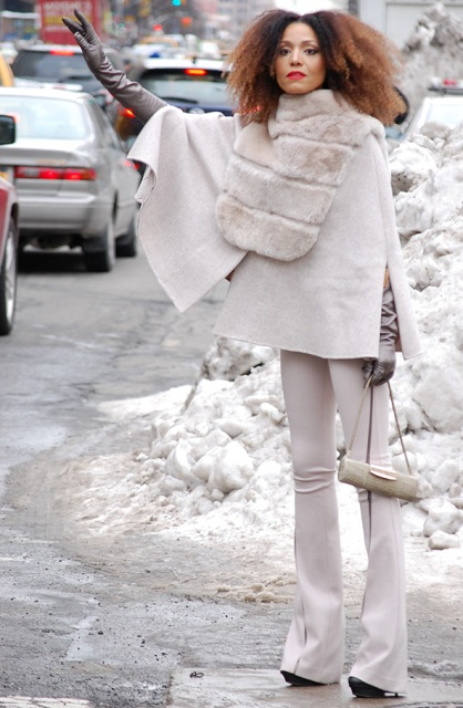 With white flare trousers, platform boots, leather gloves and mini bag