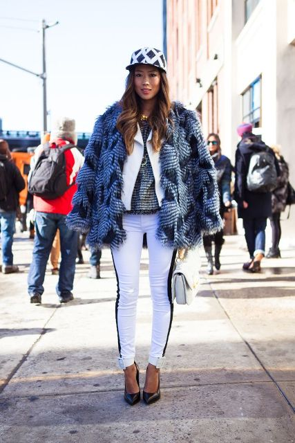 With white jacket, printed fur jacket, white pants, black shoes and white small bag