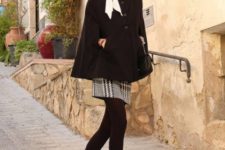 With white scarf, printed skirt, black tights and heeled shoes