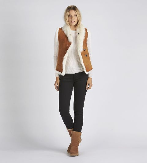 With white shirt, black skinny pants and shearling boots