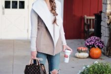 With white shirt, distressed jeans, suede ankle boots, printed bag and marsala beanie