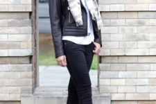 With white shirt, leather jacket, striped scarf and cuffed jeans