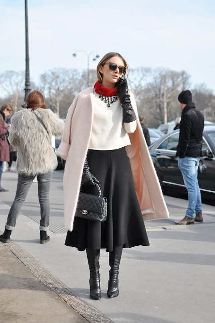 With white shirt, midi skirt, high boots and black bag