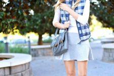 With white shirt, mini skirt, gray bag and brown boots