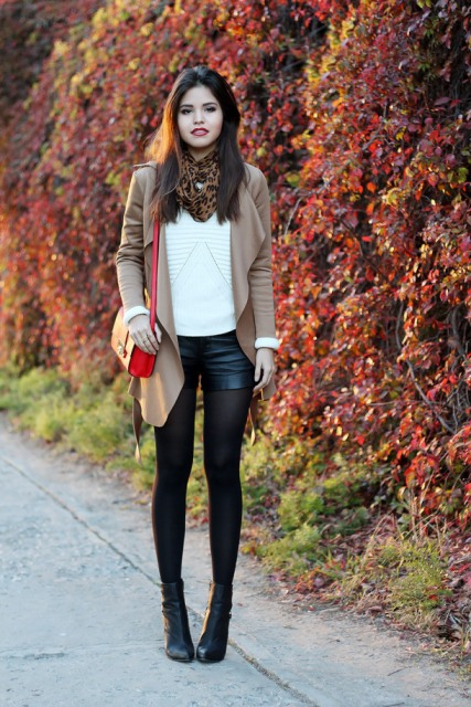 With white sweater, camel cardigan, red bag and ankle boots