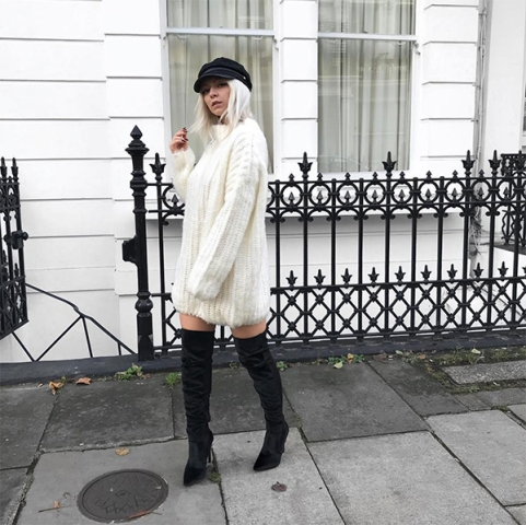 With white sweater dress and black over the knee boots