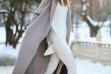With white sweater, white pants, black cut out boots and midi coat