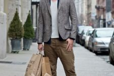 With white t-shirt, gray jacket, olive green pants and shoes