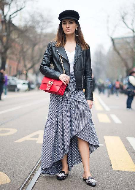 With white top, printed maxi skirt, leather jacket, shoes and red bag