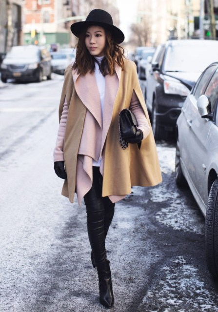 With white turtleneck, skinny pants, black wide brim hat and ankle boots