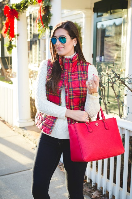 With white turtleneck sweater, pants and red bag