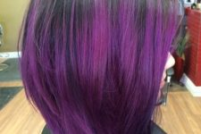 02 a black sleek short bob haircut with bold purple balayage is an ultra-modern idea