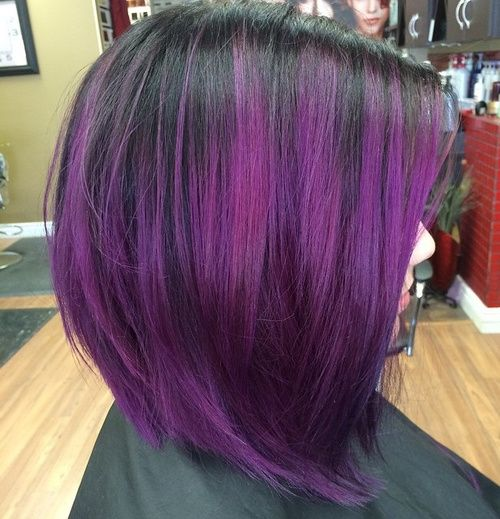 a black sleek short bob haircut with bold purple balayage is an ultra-modern idea