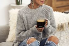 02 a comfy grey sweater with a high neckline, ripped jeans and statement earrings