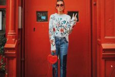 02 a floral sweater, cropped jeans, white shoes and a heart-shaped bag