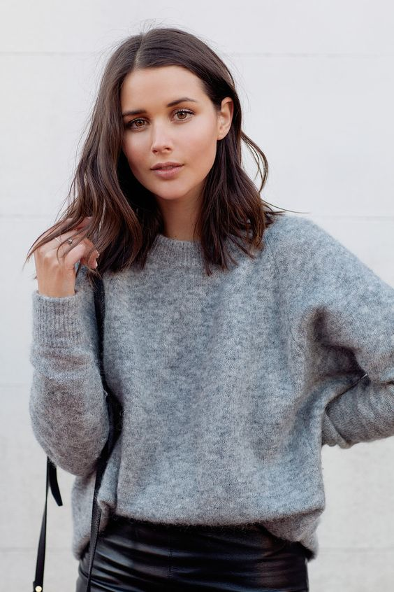 a grey cashmere sweater with a black leather skirt is a perfect idea for winter