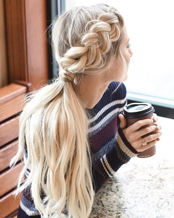 a low braided ponytail is a chic idea for sweater weather and can be worn anytime