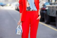 02 a red pantsuit, a printed shirt, a statement necklace and a small bag