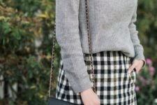 03 a grey cashmere sweater with a black bow, a checked mini skirt and tall boots