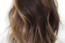 03 a shaggy brunette bob with face-framing bronde balayage to highlight the face