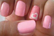 03 pink nails with a glitter accent one and a heart sticker for a bold look