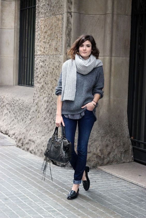 a grey tee, a grey cashmere sweater, a dove grey scarf, jeans and flats for a casual look