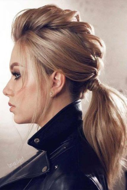 a low ponytail with a voluminous braid on top looks chic and can be worn with scarves