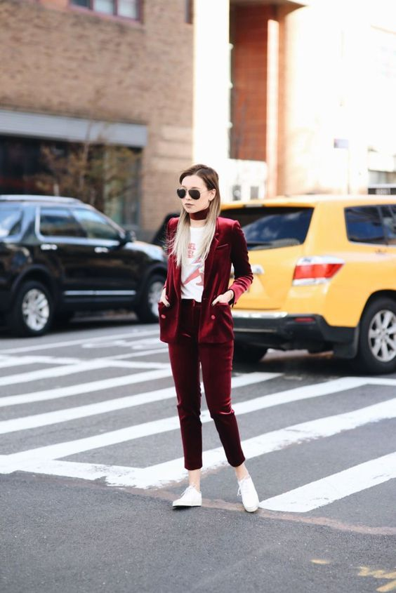 a marsala velvet pantsuit with a matching choker, a printed tee and white sneakers