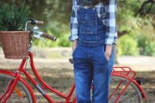 04 a plaid shirt, a denim overall, black boots, a scarf and a beanie