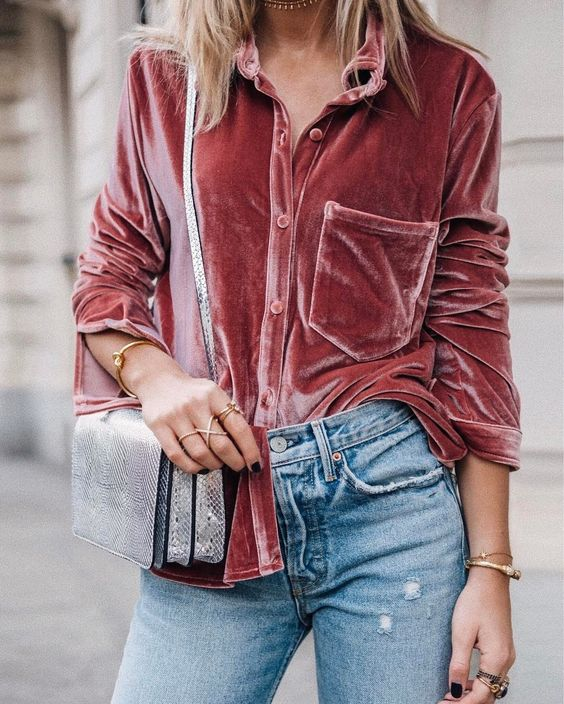 blue jeans, a pink velvet blouse and a snake print bag ffor a chic look