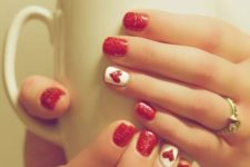 04 red glitter manicure with an accent white and red glitter heart nail