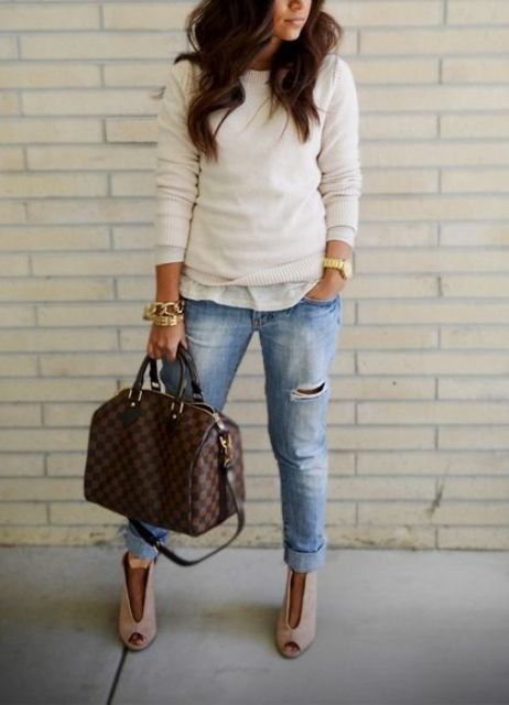 ripped jeans, a casual shirt, a neutral sweater, blush booties