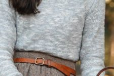 05 a tweed mini skirt, a white shirt, a grey sweater, a leather belt and bags