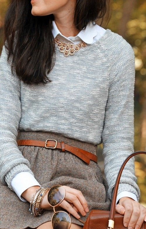 a tweed mini skirt, a white shirt, a grey sweater, a leather belt and bags