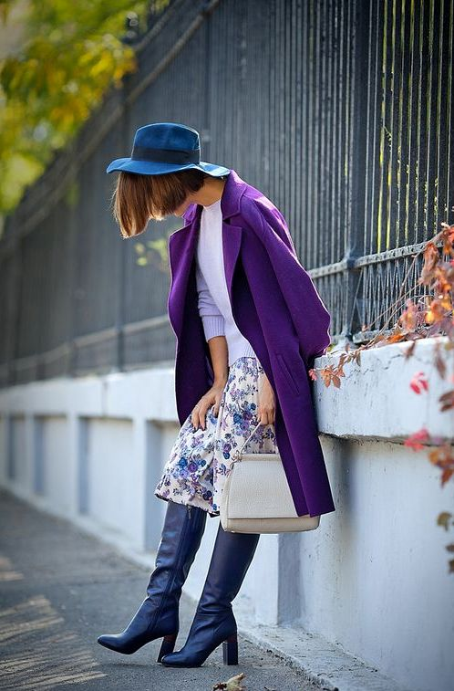 an ultraviolet coat, blue boots, a floral skirt, a lavender sweater and a blue hat for a bold look