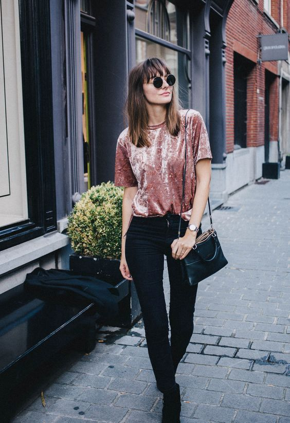 black skinnies, a pink crushed velvet tee, black boots and a black bag