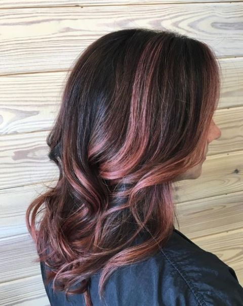 black wavy hair with rose gold and pink balayage